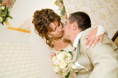 Beautiful young bride kissing groom Royalty Free Stock Photo
