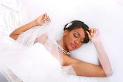 Beautiful Young Bride Laying Down Smiling Stock Image