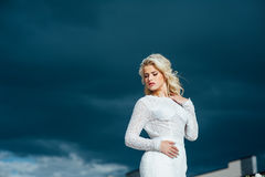 Beautiful young bride in luxury wedding dress Stock Image