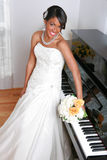 Beautiful Young Bride by Piano Stock Photo