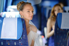 Beautiful young bride portrait in a bus. Beautiful young bride portrait in a wedding bus Royalty Free Stock Images