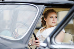Beautiful young bride portrait in a car Stock Photo
