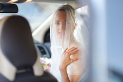 Beautiful young bride portrait in a car Stock Photography