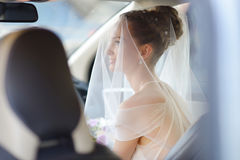 Beautiful young bride portrait in a car Stock Images