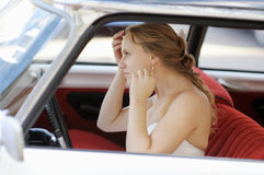 Beautiful young bride portrait in a wedding car Royalty Free Stock Images