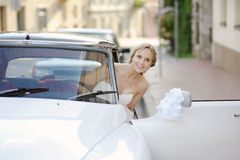 Beautiful young bride portrait in a wedding car Stock Photography