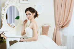 Beautiful young bride portrait with wedding makeup and dress Stock Photos