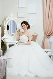 Beautiful young bride portrait with wedding makeup, hairstyle Stock Photography