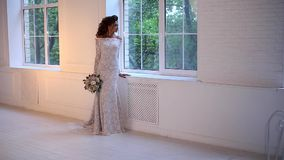 Beautiful young bride posing dolly slow motion stock video footage