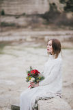 Beautiful young bride posing near lake royalty free stock photography