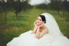 Beautiful young bride posing in spring Stock Image