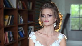 Beautiful young bride posing stock footage