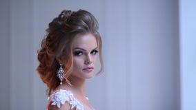 Beautiful young bride posing stock video