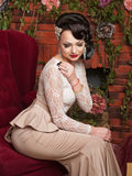 Beautiful young bride sitting in a chair Royalty Free Stock Image