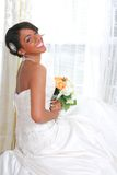 Beautiful Young Bride Sitting by Window Royalty Free Stock Photo