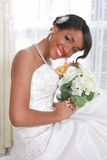 Beautiful Young Bride Sitting by the Window Royalty Free Stock Photo