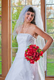 Beautiful Young Bride Standing by Window Smiling Stock Images