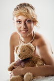Beautiful young bride with teddy bear Royalty Free Stock Photography