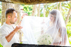 Beautiful young bride in the veil, with wedding bouquet of white Stock Photos