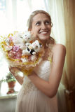 Beautiful young bride with a wedding bouquet Royalty Free Stock Images