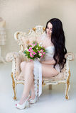 Beautiful young bride with wedding bouquet. Last preparations fo Royalty Free Stock Images