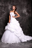 Beautiful young bride in wedding dress posing at studio Royalty Free Stock Photography