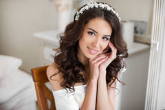 Beautiful young bride wedding makeup and hairstyle stock photo