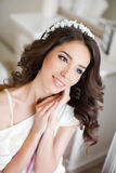 Beautiful young bride wedding makeup and hairstyle Stock Photography