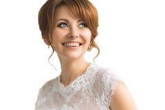Beautiful young bride with wedding makeup Stock Photos