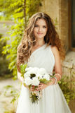 Beautiful young bride with wedding makeup and long Stock Images