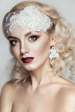 Beautiful young bride with wedding makeup  on studio background Royalty Free Stock Image