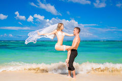 Beautiful young bride in a white bikini, veil and garter on her Stock Photo