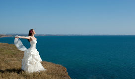 Beautiful young bride in a white dress Royalty Free Stock Photos
