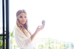 Beautiful young bride in a white dress with the mirror. Last pre Royalty Free Stock Photography