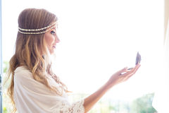 Beautiful young bride in a white dress with the mirror. Last pre Royalty Free Stock Image