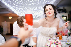 Beautiful young bride in white dress playfully Royalty Free Stock Photography