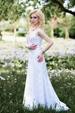 Beautiful young bride in white dress in summer green park Royalty Free Stock Photography