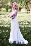 Beautiful young bride in white dress in summer green park Royalty Free Stock Photo