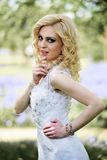 Beautiful young bride in white dress in summer green park Stock Images