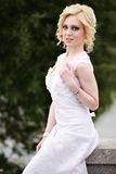 Beautiful young bride in white dress in summer green park Royalty Free Stock Photos