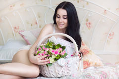 Beautiful young bride in a white dress with a wedding bouquet of Stock Photo