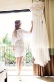 Beautiful young bride with a white wedding dress. Last preparati Stock Photo