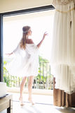Beautiful young bride with a white wedding dress. Last preparati Stock Photos