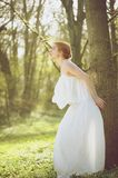 Beautiful young bride in white wedding dress standing outdoors royalty free stock photos
