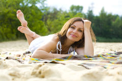 Beautiful young brown-haired woman in white sundress Royalty Free Stock Photos