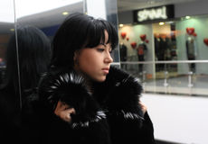 Beautiful young brunette. Portrait of a beautiful young brunette in a fur coat Royalty Free Stock Image