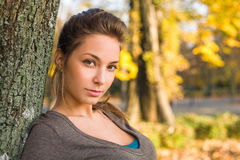 Beautiful young brunette in autumn park. Royalty Free Stock Photography