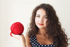 A beautiful young brunette with a ball Stock Images