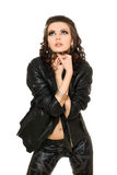 Beautiful young brunette in black clothes. Isolated Stock Photo
