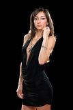 Beautiful young brunette in black dress Stock Photos